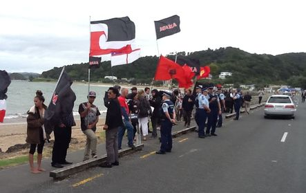 Protesters outside Te Tii Marae at Waitangi on Sunday.