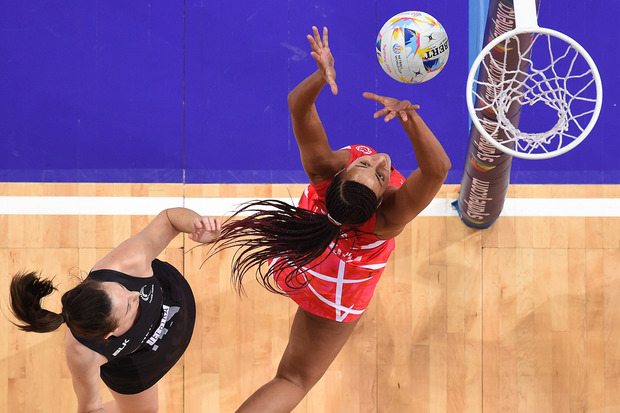 Bailey Mes of New Zealand (left) competes for the ball with Geva Mentor of England during the 1st semi-final in the Netball World Cup at Allphones Arena in Sydney.