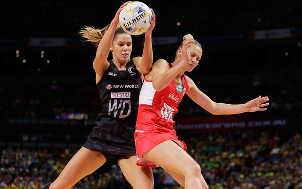 Silver Fern Kayla Cullen and Tamsin Greenway compete for the ball during the Netball World Cup semi final match between the Silver Ferns and England.