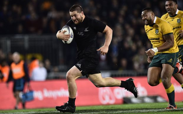 Dane Coles of the All Blacks runs in a try during the Bledisloe Cup Rugby test match between New Zealand and Australia at Eden Park