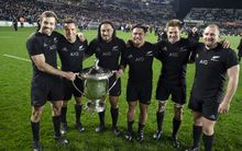 The winning All Blacks pose with the Bledisloe Cup after their 41-13 thrashing of the Wallabies.