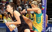 The Silver Ferns Baily Mes grapples with Australia's Julie Corletto