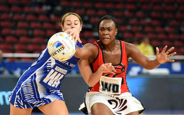 Samoa's Brooke Williams competes for the ball against Trinidad and Tobago at the Netball World Cup.
