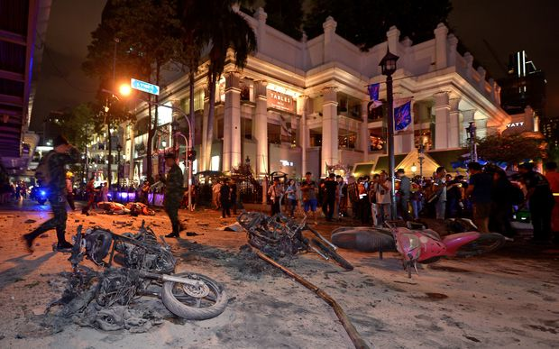 Thai soldiers inspect the scene after a bomb exploded outside a religious shrine in central Bangkok late on August 17, 2015