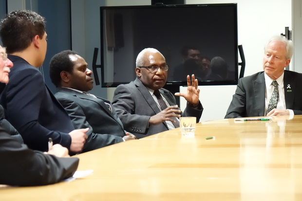 The secretary-general of the United Liberation Movement for West Papua, Octo Mote (centre) and the Movement's Pacific regional ambassador Akaboo Amatus Douw to his right, talk to New Zealand MPs, Wellington 2015.