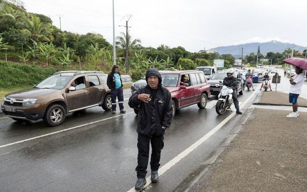Angry motorists in New Caledonia during a road blockade.