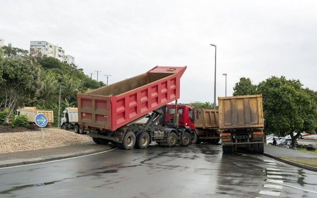 Truck blockade lifted temporarily in New Caledonia.