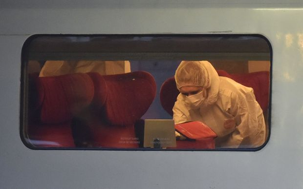 Police inspect a crime scene inside a Thalys train of French national railway operator SNCF.