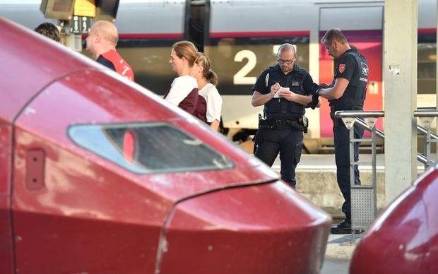 Train personnel stand next to Thalys trains at the main train station in Arras, northern France, following the shooting.