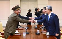 South Korean president's national security adviser, Kim Kwan-Jin (right), and unification minister Hong Yong-Pyo (2nd R) shaking hands with the North Korean military's top political officer Hwang Pyong-So (left) and North Korean top official in charge of South Korea affairs, Kim Yang-Gon (2nd L).