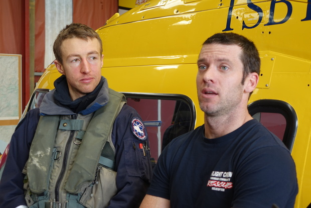 Chopper crewman Ben Wallbank (left) and pilot Mike Parker after Alan and Anne Warner were found.