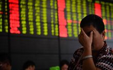 An investor at a trading hall of a securities firm in Nanjing, China,  Aug. 24, 2015.