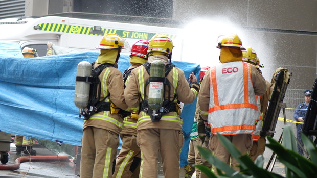 A decontamination shower underway outside the Hotel Grand Chancellor in Auckland central