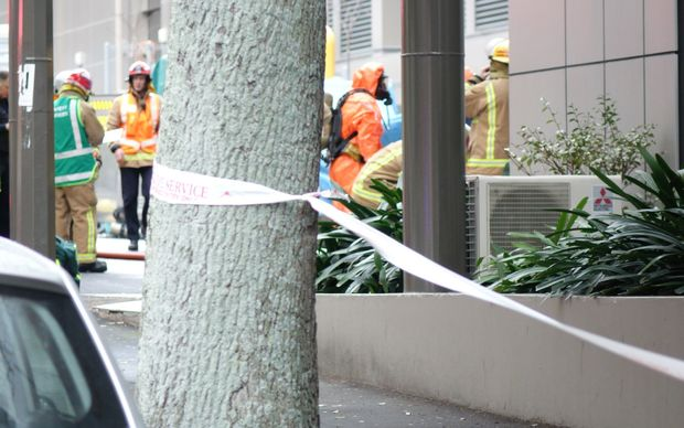 The hotel is cordoned off and emergency workers in protective clothing are at the building.