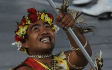 Commonwealth gold medalist David Katoatau flies the Kiribati flag.