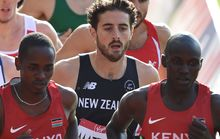Julian Matthews (centre) contests the 1500m heats at the Glasgow Commonwealth Games.