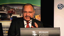 Papua New Guinea PM Peter O'Neill addresses the PNG Investment Summit in Brisbane.
