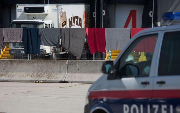 The refrigerated truck, in which bodies of 71 migrants were found, parked at the border in Nickelsdorf, Austria.