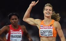 Dafne Schippers celebrates as she wins the 200m in Beijing, 2015.