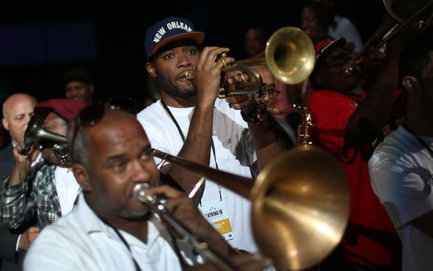 Band members play during a second line parade marking the 10th anniversary of Hurricane Katrina on August 29, 2015 in New Orleans, Louisiana