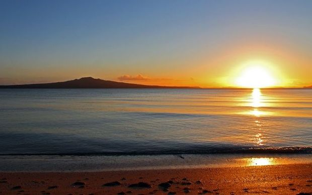 Auckland has much better weather than the capital and a beautiful environment, says Phil Goff. (Image shows sun rising behind Rangitoto Island)