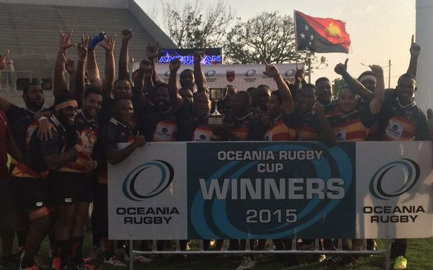Papua New Guinea players celebrate winning the Oceania Cup rugby tournament.