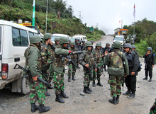 Indonesian soldiers and policemen deployed on the main Timika road to the Freeport mine