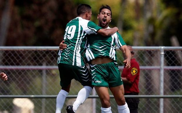 Cook Islands striker Taylor Saghabi celebrates a goal.