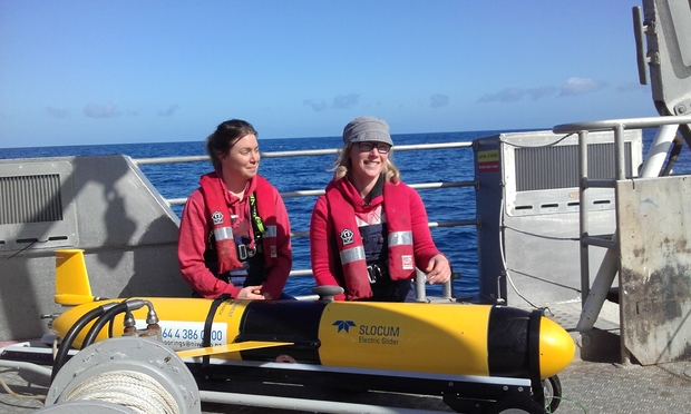 Happy reunion: NIWA oceanographer Joanne O'Callaghan (right) and technician Fiona Elliott with the glider Manaia.