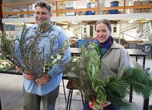 Tim Curran and Sarah Wyse with bouquets of native and introduced plants: they are testing the flammability of different species used in green shelter belts.