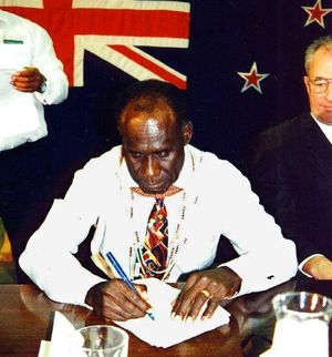 "PNG Bougainville Premier Gerard Sinato signs the ""Burnham Declaration"" in 1997, which set in motion an end to the civil war."