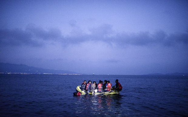 Migrants board a boat to the Greek island of Ko off the shore of Bodrum, southwest Turkey.
