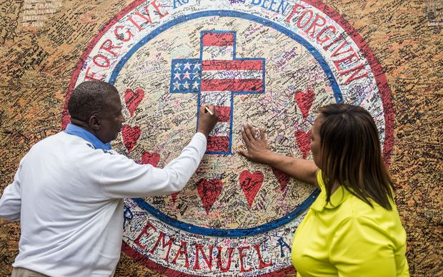 A memorial in front of Emanuel AME Church on July 31, 2015 in Charleston, on the day Dylann Roof was arraigned on 33 federal charges.