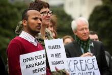 Protesters gather at Parliament for the Government to increase the refugee quota.