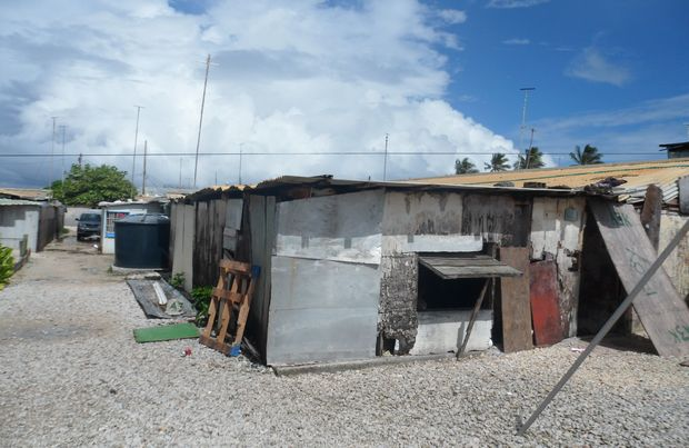 "Overcrowded and dilapidated housing conditions are the norm for islanders from Kwajalein's ""mid-corridor"" who were evacuated 50 years ago to make way for missile testing. Marshall Islands."