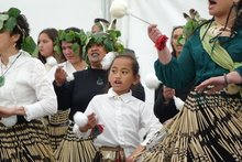 Nataria Winikerei, 7, as the story of Parihaka is performed at the Taranaki Treaty settlement yesterday.