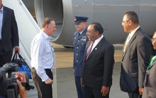 John Key is met by the PNG Foreign Minister Rimbink Pato, in Port Moresby.