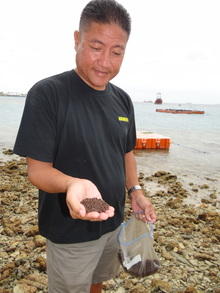 The mayor of Rongelap James Matayoshi with feed for the fish farming project