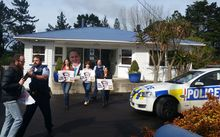Show Us Ya Text protesters were moved on from John Key's electoral office by police.
