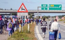 Refugees walking north along the Danish E45 motorway.