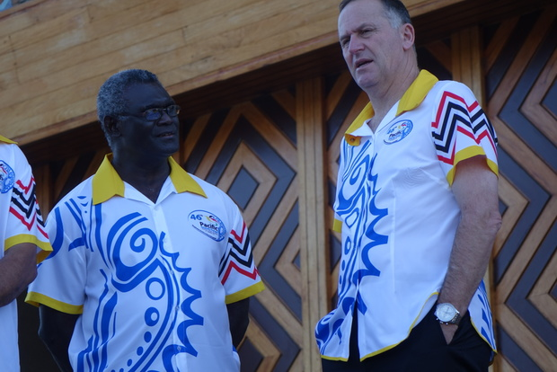 Solomon Islands prime minister Manasseh Sogavare talks to his New Zealand counterpart John Key at the 205 Pacific Forum summit in Port Moresby.