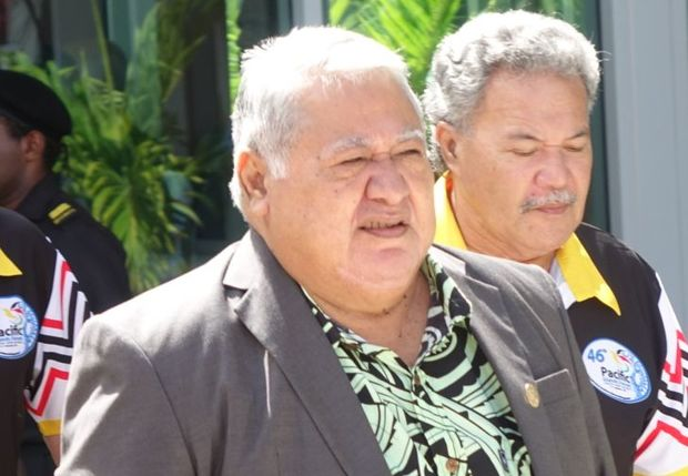 Samoa's Prime Minister, Tuilaepa Sailele Malielegaoi. In the background is Tuvalu's Prime Minister Enele Sopoaga