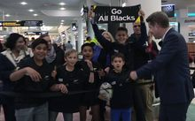 Fans waiting for the All Blacks at Auckland Airport ahead of 2015 Rugby World Cup.