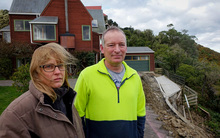 Nichola and Mark Goodier are unable to return to their Bastia Hill home and are becoming frustrated with delays in dealing with EQC.