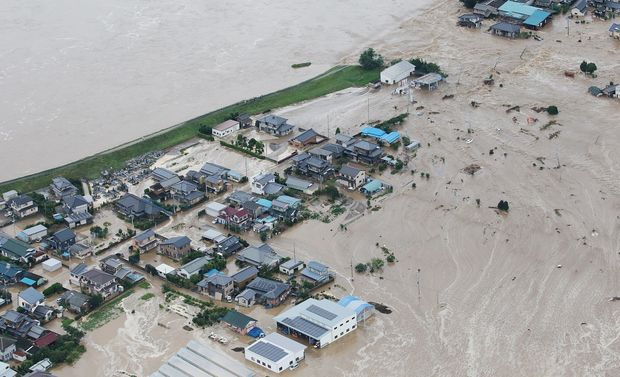 Floodwaters from the burst Kinugawa river flow into a residential area in Joso, Ibaraki.