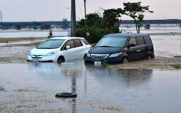Submerged vehicles in floodwaters after an embankment of the Kinugawa river collapsed.