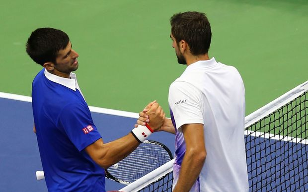 Novak Djokovic (L) greets Marin Cilic at the net after their match in New York