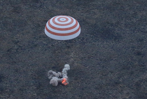 A three-person crew from the International Space Station lands safely in the steppes of Kazakhstan.