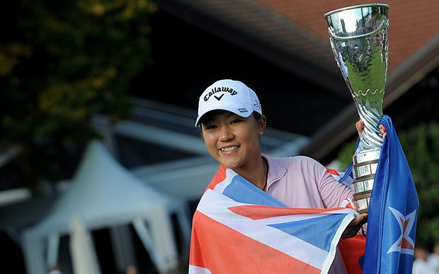 Lydia Ko with her trophy after winning the Evian Championship on September 13, 2015 in the French Alps town of Evian-les-Bains.