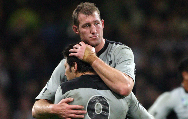 Chris Jack consoles Byron Kelleher after the All Blacks' quarter-final loss to France in Cardiff, 2007